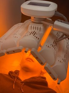LED light used after extraction facial to calm skin.