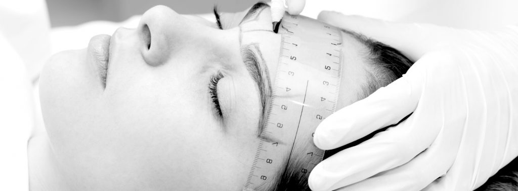 Picture showing drawing up of the shape before eyebrow tattoo